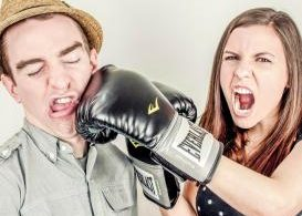 woman punching man with boxing glove