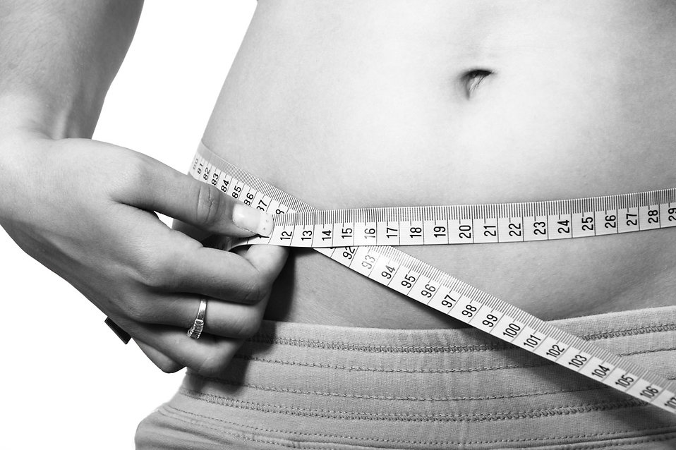 11707-a-woman-measuring-her-belly-pv.jpg